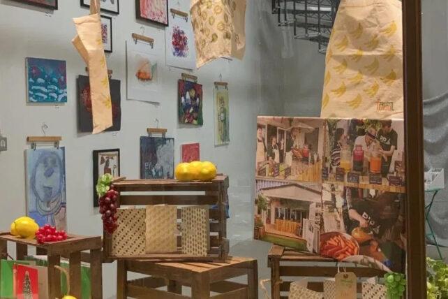 View through a shop window to an exhibition